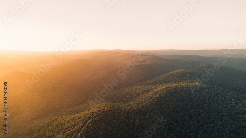 Obraz Aerial View of Sunset Over Beautiful Forest Landscape Along the Great Ocean Road, Victoria Australia - fototapety do salonu