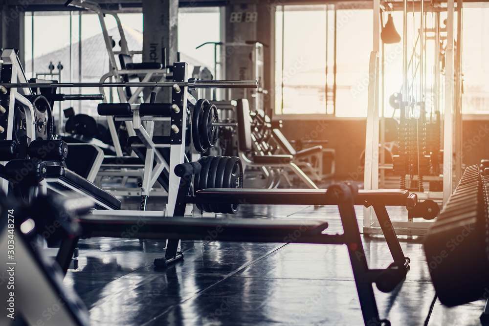 Fototapety, obrazy: interior background of room in gym or fitness center fully equip of bodybuilding equipments and machines