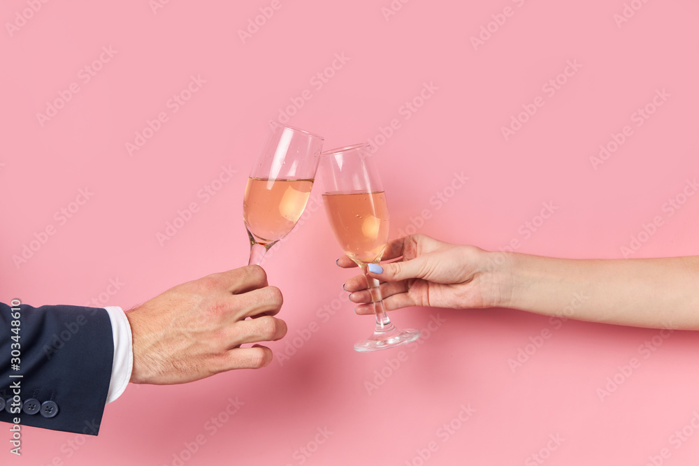 Fototapety, obrazy: Unrecognizable man and woman with glasses of champagne isolated.
