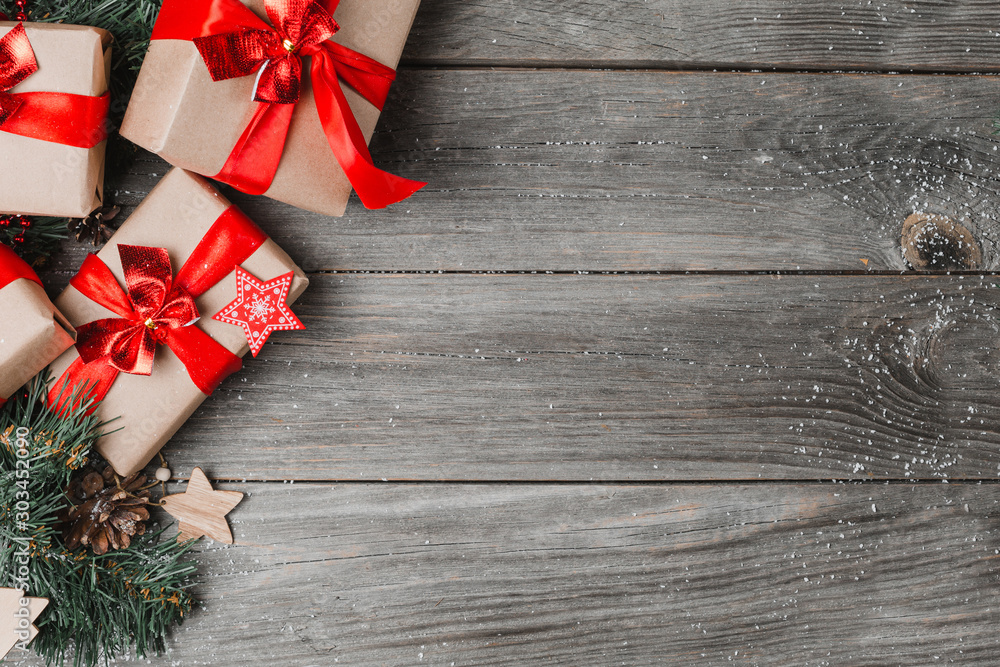 Fototapeta Present Boxes With Ribbons On Wooden Background