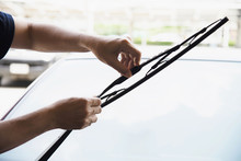 Man Doing Car Wiper Cleaning Or Changing Maintenance - People With Car Maintenance Concept