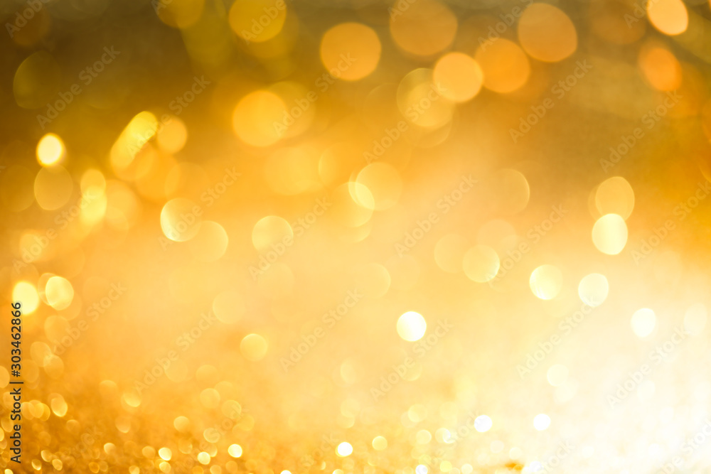 Fototapety, obrazy: Abstract bokeh of glowing yellow lights and sparkling gold glitter background or wallpaper