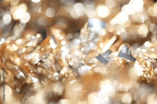 Obraz Abstract bokeh of sparkling gold and silver Christmas tinsel background - fototapety do salonu