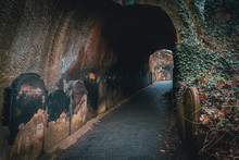 LIVERPOOL, ENGLAND, DECEMBER 27, 2018: Spooky Entrance To The Scary Dark Tunnel To The St James's Cemetery Beside Liverpool Cathedral, With Walls Shaped By Old Moldy Gravestones