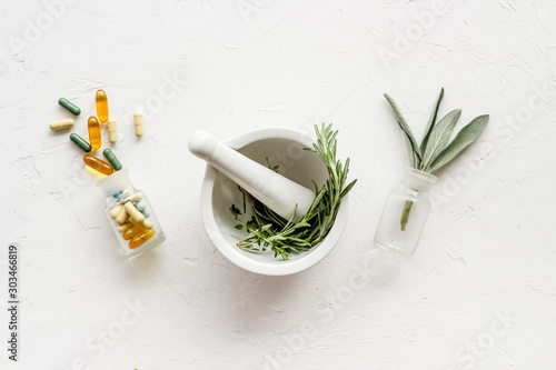 Photo  Herbal formulations for health care - herbs and drugs on white background top vi