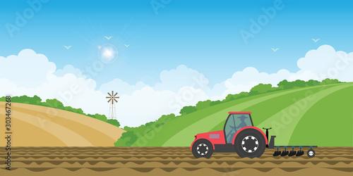 Fototapeta Farmer driving a tractor in farmed land on rural farm landscape hill background. obraz