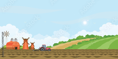 Farmer driving a tractor in farmed land and farmhouse. Poster Mural XXL