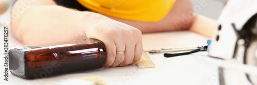 Valokuva Arm of drunken worker in yellow helmet hold liquor