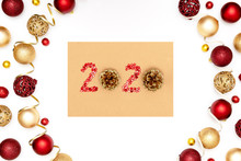 2020 Made Of Red Sparkles And Decorative Christmas Toys On Craft Sheet Of Paper.