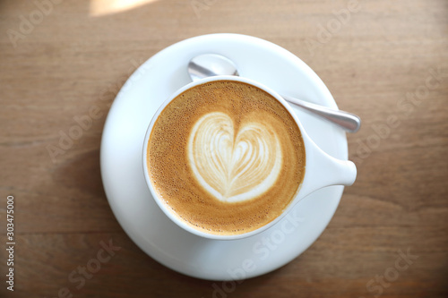 Foto auf AluDibond Kaffee cappuccino or Latte art coffee made from milk on the wood table in coffee shop