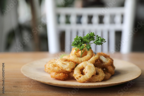Fototapeta Caramari , Appetizer Crispy fried squid ring with tartar sauce on wood background traditional italian food obraz