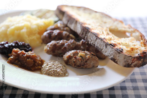 Grilled sausage with bread and potato and fruit jam sauce cuisine Wallpaper Mural