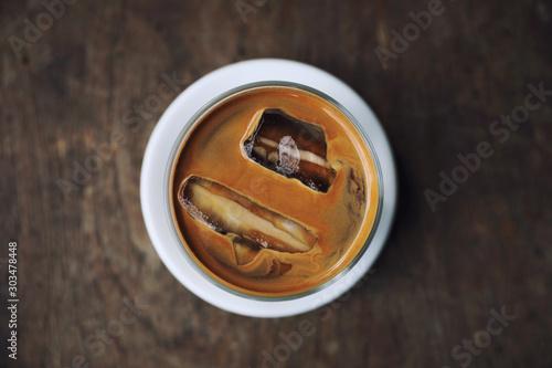 ice latte coffe on wood in coffee shop