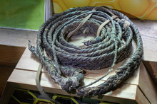 Old Thick Thick Leather Rope Made By Hand On Wooden Background