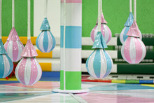 Merry-go-round Attraction For Toddlers On Playground. Pear-shaped Soft Seats Colored In Pink And Blue Colors. Entertainment For Happy Children.