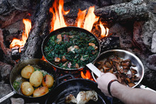 Campfire Red Meat In Pan, Near The Fire Outdoors. Bushcraft, Adventure, Tea, Knife And Camping Concept.