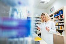 Pharmacist Reading Prescriptio...