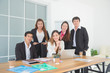 Group of asian business people in office,they looking and smile at camera. Business teamwork concept.