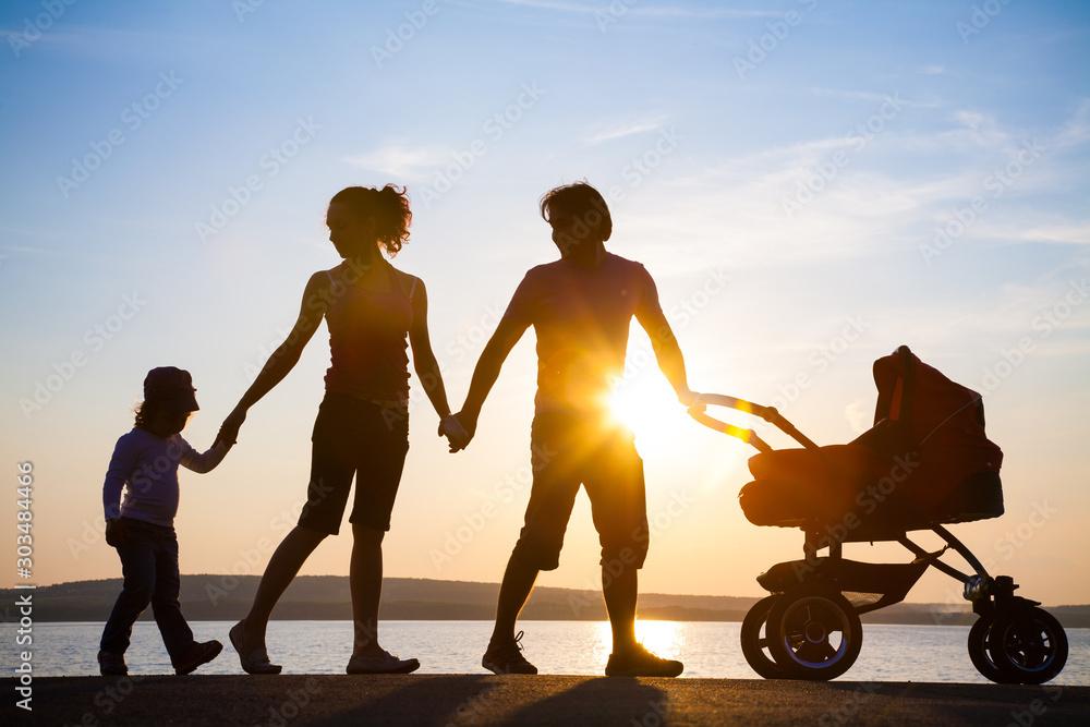 Fototapety, obrazy: happy family walking on sunset
