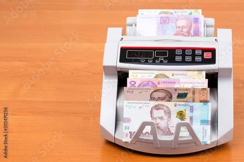 Obraz na plátně  Ukrainian money in a counting machine