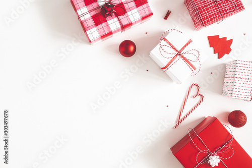 Fototapeta Christmas composition. Gift box, christmas decorations on white background. Flat lay, top view, copy space obraz na płótnie