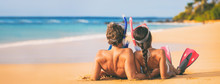 Beach Couple Relaxing On Summer Honeymoon Vacation With Snorkel Equipment. People Lying Down On Golden Sand At Sunset With Diving Mask, Flippers Sun Tanning Enjoying Travel Holiday Lifestyle.