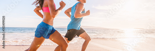Fototapeta Run fit people running on beach with healthy toned legs body, Hamstring muscles, knee joint health active lifestyle panoramic banner background. obraz