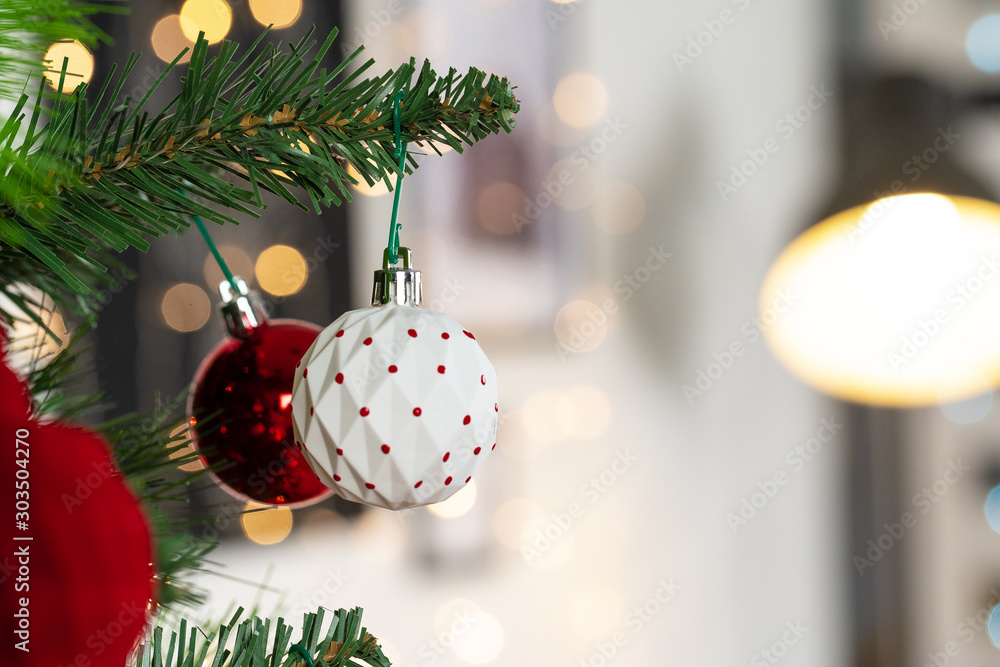 Fototapety, obrazy: Red and white baubles hanging from a Christmas tree close up