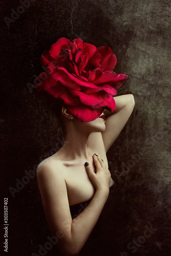 Obraz Strange fine art concept. The body of a woman, her head is a red rose. - fototapety do salonu
