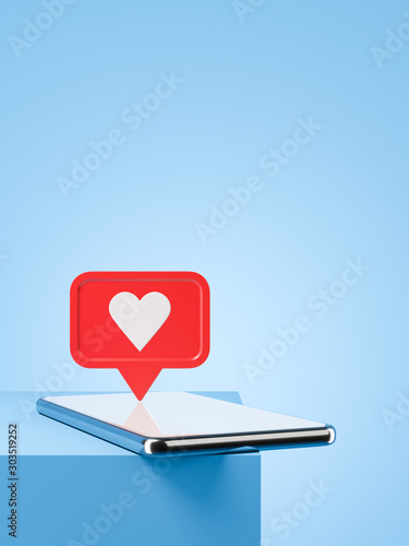 Fototapeta Smartphone with new red like notification on the blue table