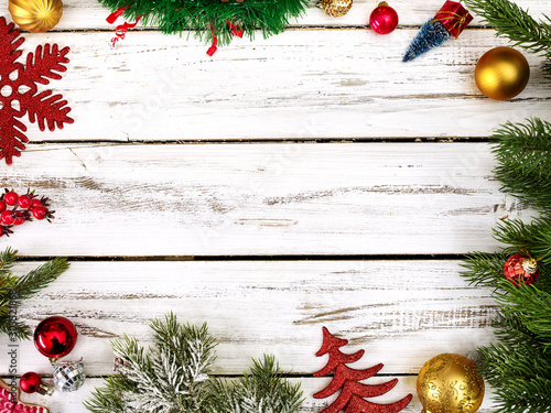 Christmas frame ball decorations and tinsel with copy space from white wooden boards.