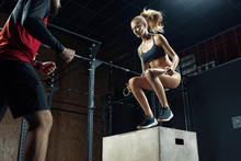 Man And Woman Crossfit Workout...