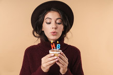 Woman Holding Cupcake With Hap...