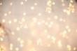 Leinwandbild Motiv Background of New Year's garlands like stars. Christmas atmosphere with garlands in focus and defocus.