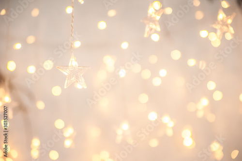 Fotografiet  Background of New Year's garlands like stars