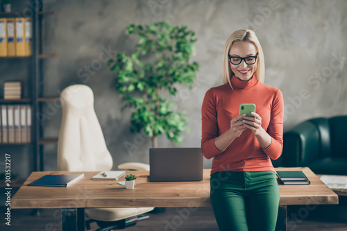 Portrait of smart company owner woman use smartphone chatting with employees col Wallpaper Mural