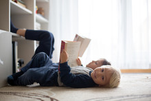 Cute Child, Boy, Reading A Book At Home