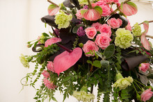 Roses Carnations And Greenery Form A Beautiful Flower Display Suitable For Church Or Wedding.