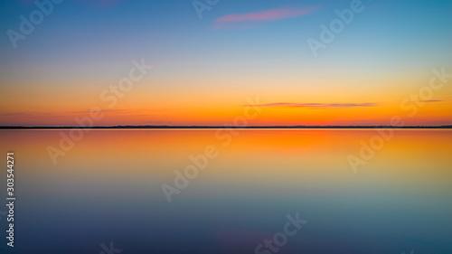 Montage in der Fensternische Pier sunset over the sea