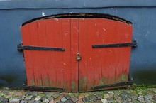 Old Vintage Ancient Blue Building House Castle Paving Stones Basement Cellar Tunnel Red Brown Dirty Wood Wooden Aged Shabby Paint Door With Metal Lock And Iron Steel Rust Rustic Rusty Door Hinges