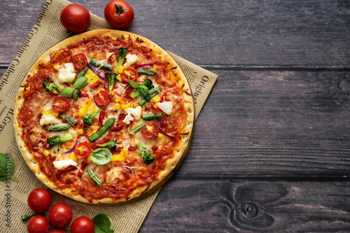 Fototapeta Delicious vegetarian rustic pizza served on wooden table obraz