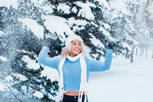 Beautiful Afro American Girl Playing With Snow In Park