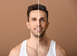 canvas print picture - Portrait of handsome man on color background