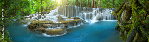 Panoramic beautiful deep forest waterfall in Thailand - 303570201