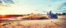 Teen Riding ATV In Sand Dunes ...
