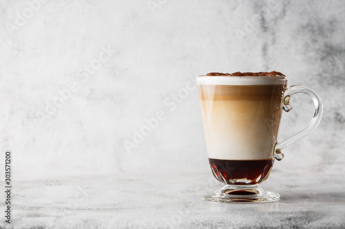 Fotografie, Obraz Coffee with Irish whiskey and whipped cream in glass isolated on bright marble background