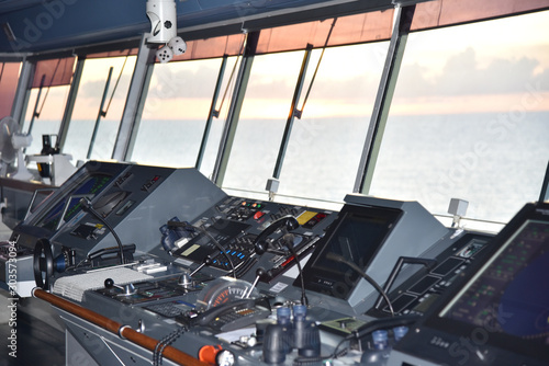 View of the control console on the navigational bridge of the cargo ship Canvas-taulu