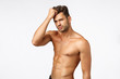 canvas print picture - Advertisement, beauty and masculinity concept. Handsome, sassy and sexy young man promote healthy lifestyle, workout, bodybuilding or beauty haircare products, stand naked torso, touching haircut