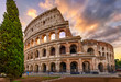 Sunrise view of Colosseum in Rome, Italy. Architecture and landmark of Rome. Postcard of Rome.