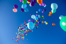 Colorful Balloons Flying In Th...